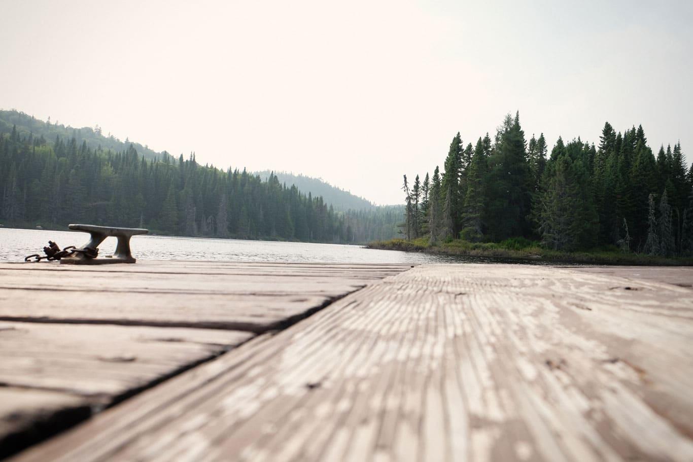 dock overlooking lake and mountains